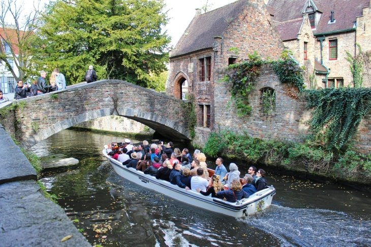 Bonifacius Bridge and canal boat bruges roseanna sunley travel blog